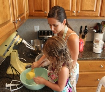 Lola helping make Olive's cake